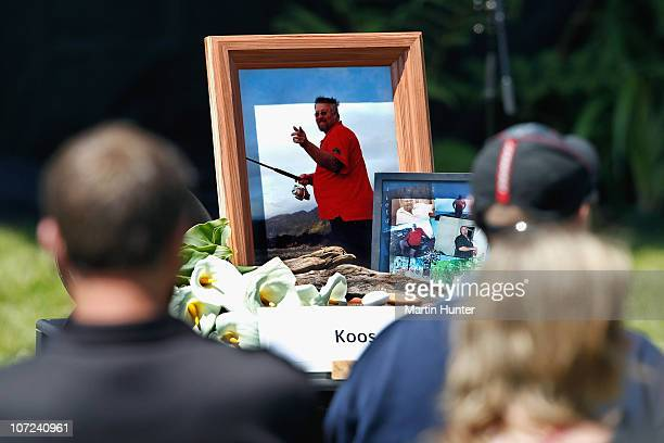 Members of the service look on during a national memorial service for the 29 miners that lost their lives in the Pike River Mine at Omoto Racecourse...