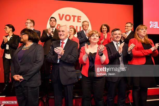 Members of the shadow cabinet applaud as Labour party leader Jeremy Corbyn launches the party's general election campaign at Event City on May 9 2017...