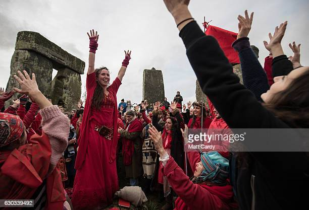 Members of the Shakti Sings choir sing as druids pagans and revellers gather in the centre of Stonehenge hoping to see the sun rise as they take part...