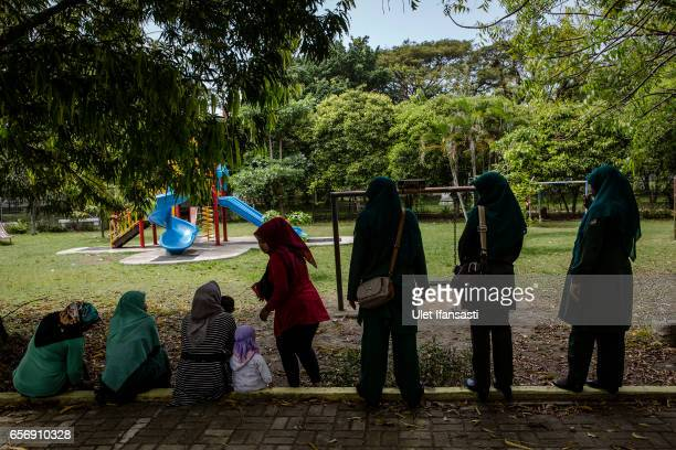 Members of the sharia police woman known as Wilayatul Hisbah speak to women who are wearing tights which goes against the prevailing sharia law on...