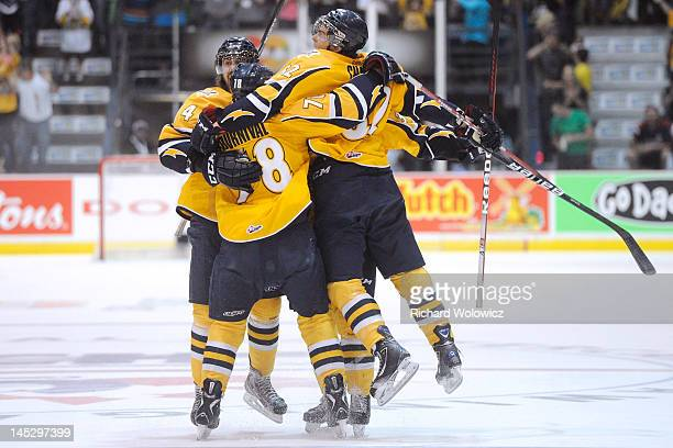 Members of the Shawinigan Cataractes celebrate the first period goal from teammate Brandon Gormley of the during the 2012 MasterCard Memorial Cup...
