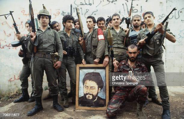 Members of the Shia Muslim Amal Militia in South Lebanon April 1982 They are posing with a portrait of Grand Ayatollah Musa alSadr cofounder of the...