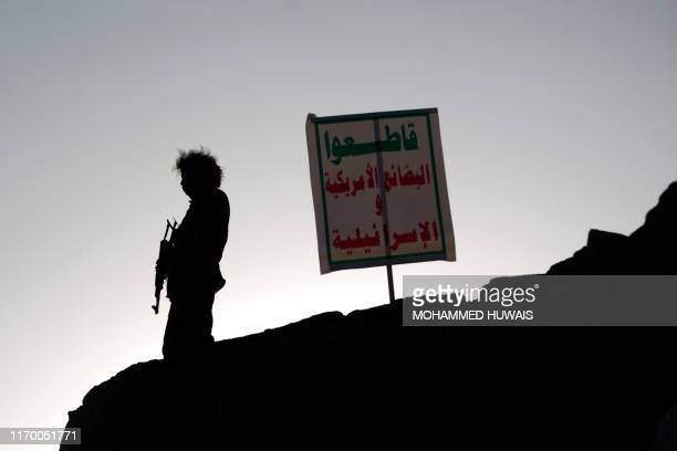 TOPSHOT Members of the Shiite Huthi movement stand guard during a rally to commemorate the fifth anniversary of the Huthi takeover of the capital...