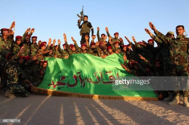 Members of the Shiite Muslim Mehdi Army militia take part in training in the southern Iraqi city of Basra on June 17 2014 Iraqi Shiite volunteers who...