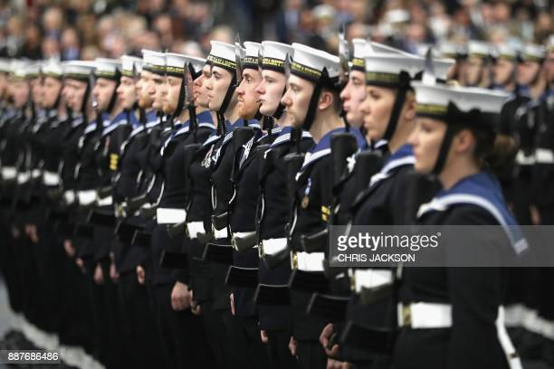 Members of the ship's company are seen during the Commissioning Ceremony for the Royal Navy aircraft carrier HMS Queen Elizabeth on board the ship at...