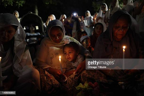 Members of the Sikh and Oak Creek community hold a candlelight service on Tuesday August 7 at Miller Park in Oak Creek Wisconsin for the six members...