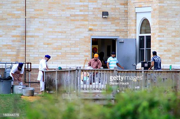 Members of the Sikh community return to temple for the first time since the mass shooting at the Sikh Temple of Wisconsin took place August 2012 in...