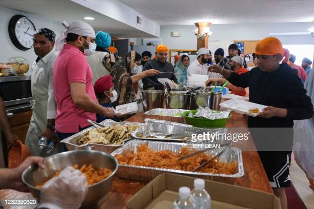 Members of the Sikh community serve food during a gathering at the Sikh Satsang of Indianapolis in Indianapolis, Indiana on April 18, 2021. - A...