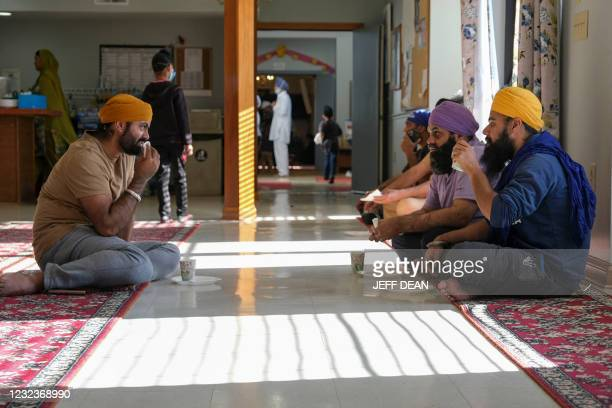 Members of the Sikh community share a meal at the Sikh Satsang of Indianapolis in Indianapolis, Indiana on April 17, 2021. - A former FedEx employee...