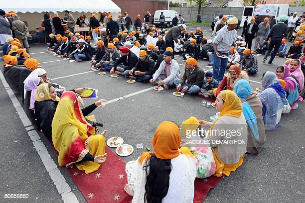 Members of the Sikh community share a meal during their Baisakhi celebrations in Bobigny suburb of Paris on April 13 2008 Hundred of French Sikhs...