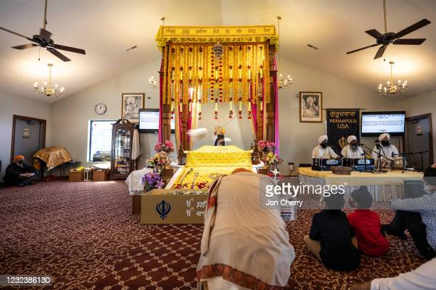 Members of the Sikh community sit in the prayer hall at the Sikh Satsang of Indianapolis on April 18, 2021 in Indianapolis, Indiana. Four of the...