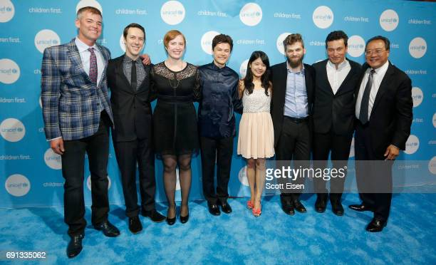 Members of the Silk Road Ensemble pose for a photo with Honoree Children's Champion Award UN Messenger of Peace Cellist YoYo Ma during UNICEF...