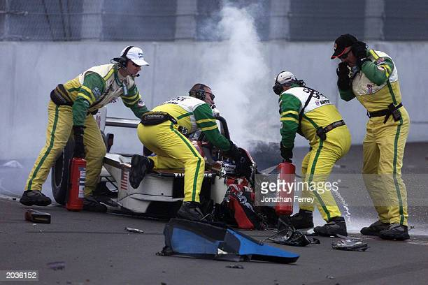 Members of the Simple Green Safety team arrive to assist the injured Alessandro Zanardi in the Mo Nunn Racing Honda Reynard after Alexandre Tagliani...