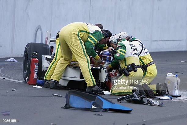 Members of the Simple Green Safety team assist the injured Alessandro Zanardi in the Mo Nunn Racing Honda Reynard after Alexandre Tagliani driving...