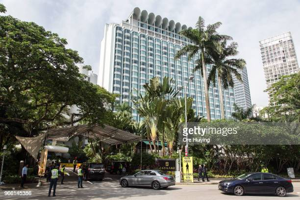 Members of the Singapore Police Force conduct security check at the Shangrila Hotel during the ShangriLa Dialogue on June 2 2018 in Singapore US...