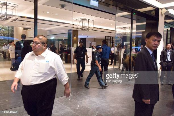 Members of the Singapore Police Force exit the Shangrila Hotel during the Shangrila Dialogue on June 2 2018 in Singapore US President Donald Trump...