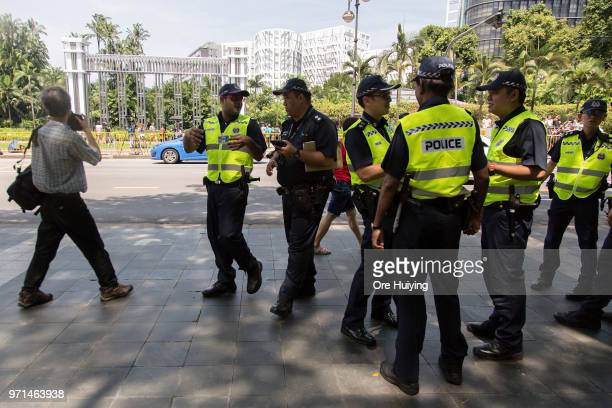Members of the Singapore Police Force stand on duty outside the Istana presidential residence on June 11 2018 in Singapore The historic meeting...