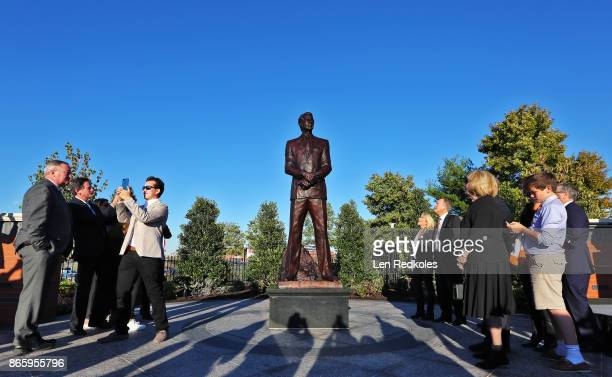 Members of the Snider Family and invited guests react toward a statue of the late Philadelphia Flyers Owner and Founder Ed Snider was unveiled during...