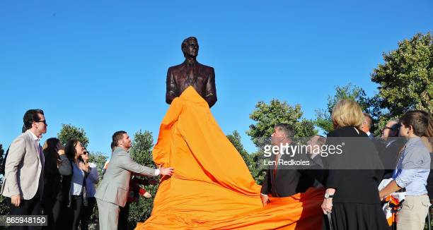 Members of the Snider Family and invited guests react toward the unveiling of a statue of the late Philadelphia Flyers Owner and Founder Ed Snider...