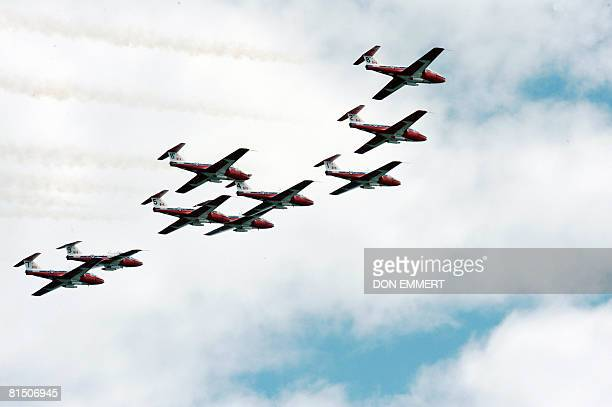 Members of the Snowbirds precision squadron fly over the Canadian Formula One Grand Prix June 8 2008 at the Circuit Gilles Villeneuve track in...