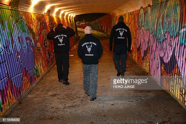 Members of the socalled Soldiers of Odin volunteer street patrol are pictured as they patrol through the streets of Drammen Norway on Sunday night...