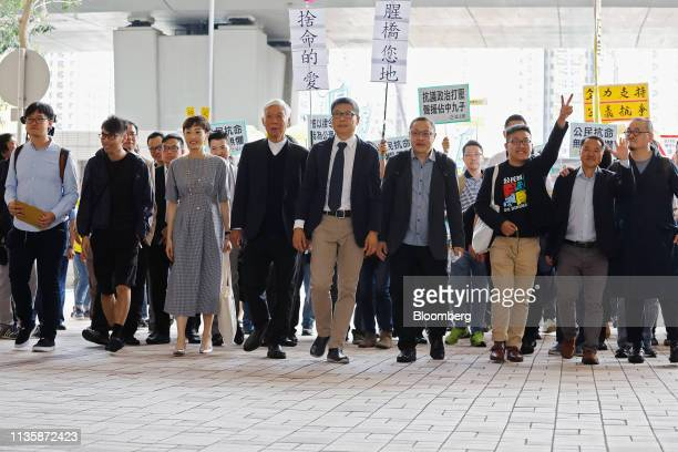 Members of the socalled Umbrella Nine democracy activists Tommy Cheung Sauyin from left Eason Chung Yiuwa Tanya Chan Chu Yiuming Chan Kinman Benny...