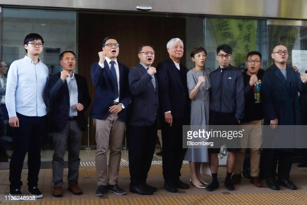 Members of the socalled Umbrella Nine democracy activists Tommy Cheung Sauyin from left Lee Wingtat Chan Kinman Benny Tai Chu Yiuming Tanya Chan...