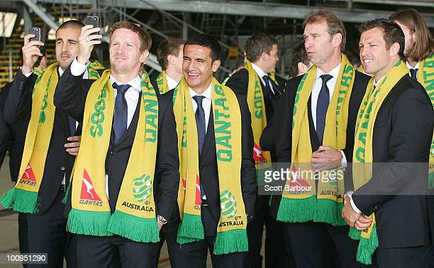 Members of the Socceroos including coach Pim Verbeek and captain Lucas Neill prepare to board their aircraft during the Australian Socceroos farewell...