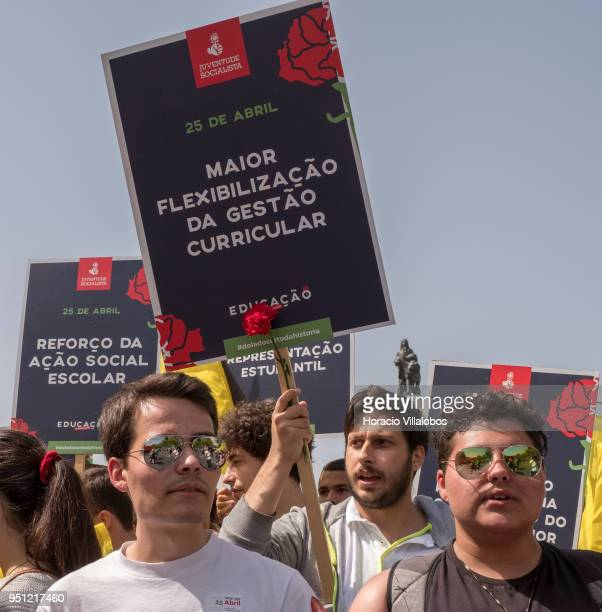 Members of the Socialist Youth walk through Avenida da Liberdade during the parade to celebrate the 44th Anniversary of the Carnation Revolution on...