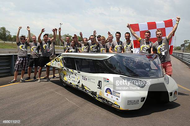 Members of the Solar Team Eindhoven pose with their car after claiming pole position following the dynamic time trials for the 2015 Bridgestone World...