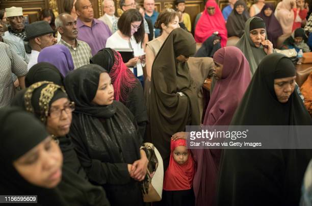 Members of the Somali community listened as Governor Mark Dayton spoke about latest developments in the Justine Damond shooting at the capitol...