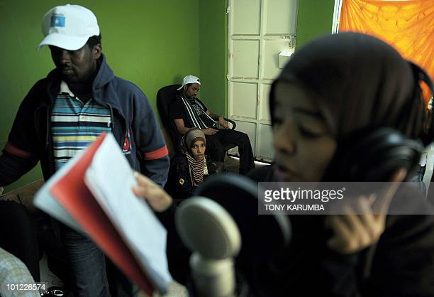 Members of the Somali rap group Waayaha Cusub prepare on May 20 2010 for a recording session at a makeshift studio in Nairobi Refugees in Kenya since...