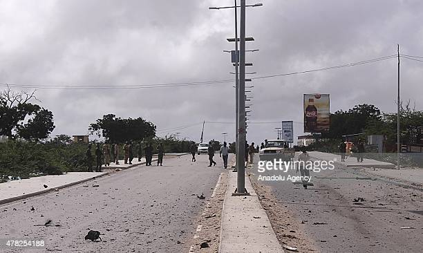 Members of the Somalian security forces patrol at the scene after a car bombing attack on United Arab Emirates embassy convoy killed seven and...