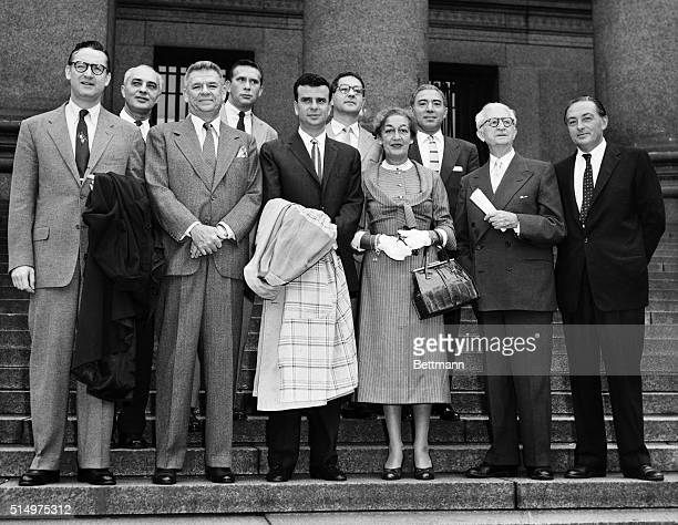 Members of the Songwriters Protective Association pose on the steps of Federal Court here September 17th before a spokesman for the group told the...