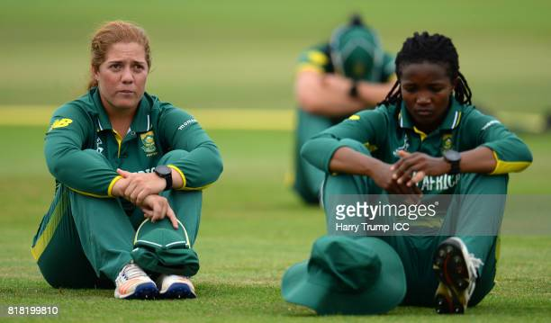Members of the South Africa side cut dejected figures during the ICC Women's World Cup 2017 SemiFinal match between England and South Africa at The...