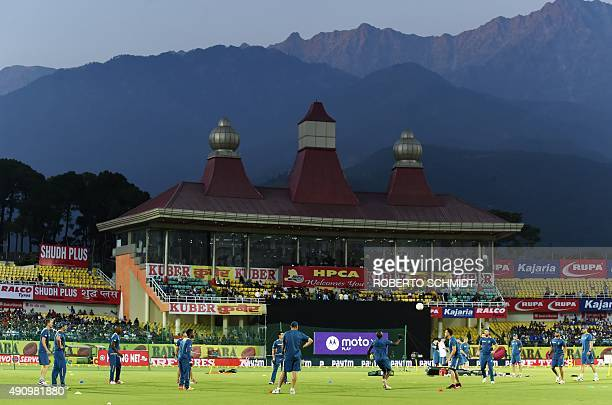 Members of the South African cricket team warm up with a football before the first T20 cricket match between India and South Africa at the Himachal...