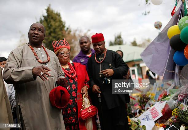Members of the South African Igbo community gather to pray as they pay tribute to Former South African President Nelson Mandela at the memorial wall...