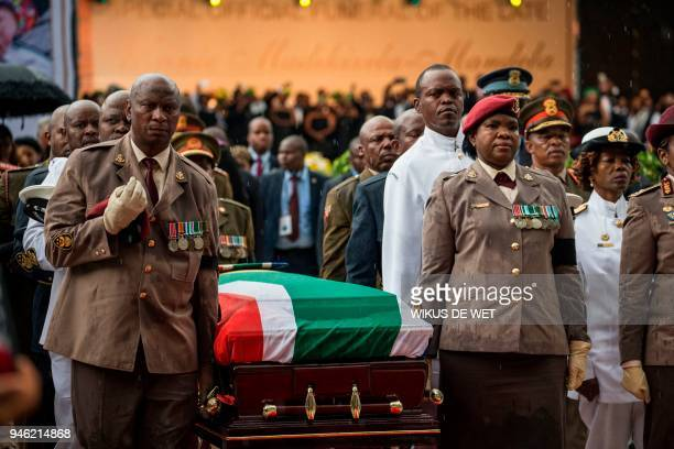 Members of the South African military carry the coffin of antiApartheid icon Winnie Madikizela Mandela during her funeral at the Orlando Stadium in...