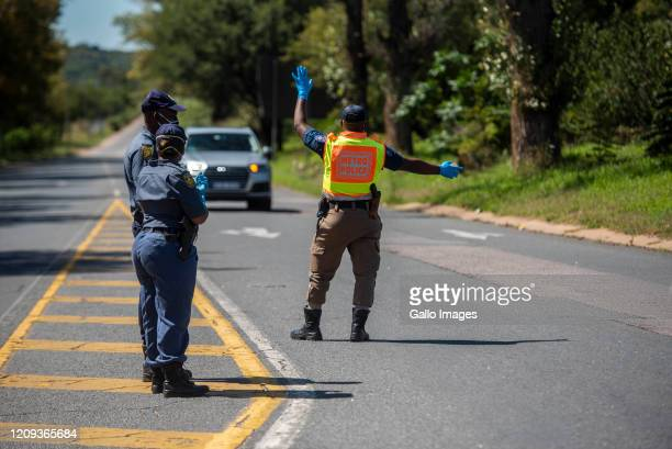 Members of the South African Police Service Tshwane Metro Police and South African National Defence Force operating a roadblock in Hatfield during...