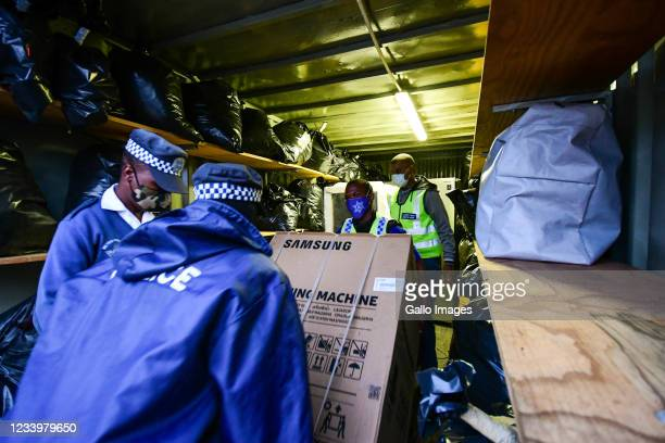 Members of the South African Police Services brief the media on confiscated goods in Durban CBD on July 133, 2021 in Durban, South Africa. It is...