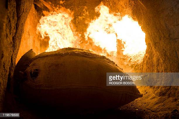 Members of the South African Police Services burn 800 kilos of marijuana in an incinerator at the SAPS Forensics Laboratory in Delft about 35 kms...
