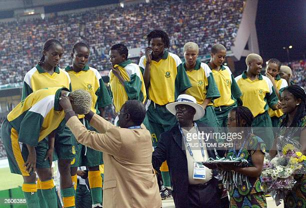 Members of the South African women's soccer team receive their silver medals late 16 October 2003 after losing the gold to Nigeria in the All Africa...