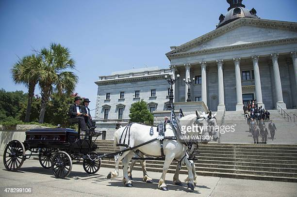 Members of the South Carolina State Legislature walk out as the casket of church pastor and South Carolina State Sen Clementa Pinckney arrives at the...