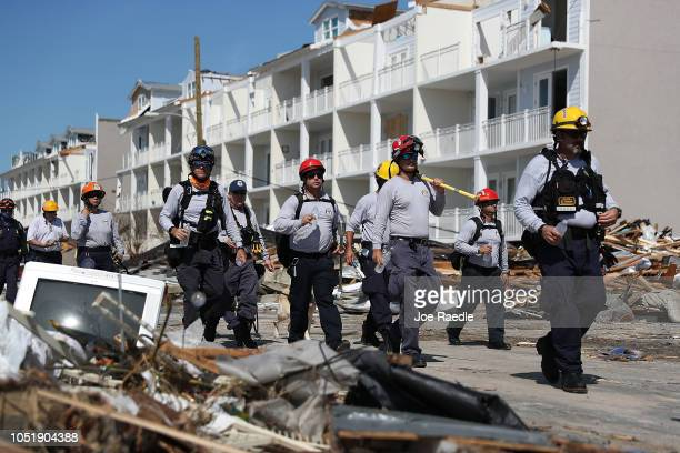 Members of the South Florida Search and Rescue team search for survivors in the destruction left after Hurricane Michael passed through the area on...