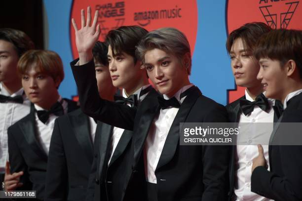 Members of the South Korean boy group NCT 127 pose on the red carpet upon their arrival to the MTV Europe Music Awards at the FIBES Conference and...