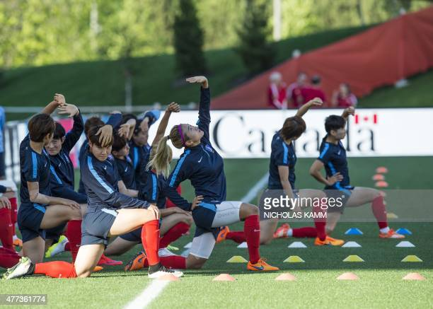 Members of the South Korean national team take part in a training session at Lansdowne Stadium in Ottawa on June 16 2015 on the eve of the team's...