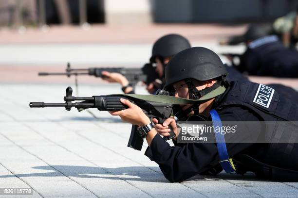 Members of the South Korean Special Weapons and Tactics team aim their weapons during a simulated chemical terrorism crisis as part of an antiterror...