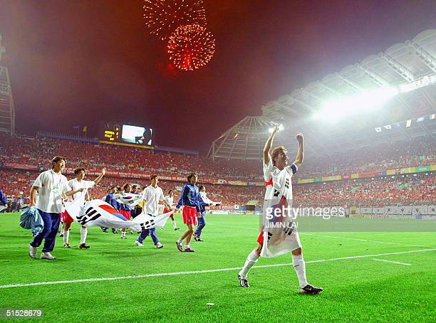 Members of the South Korean team celebrate following their victory over Italy in extra time in the second round of the 2002 FIFA World Cup...