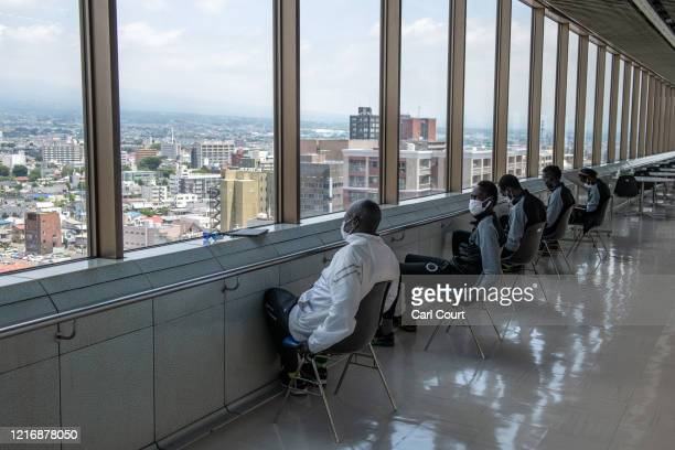 Members of the South Sudanese Olympic team chat as they enjoy the view from Maebashi City Hall on June 2 2020 in Maebashi Gunma Japan The four South...