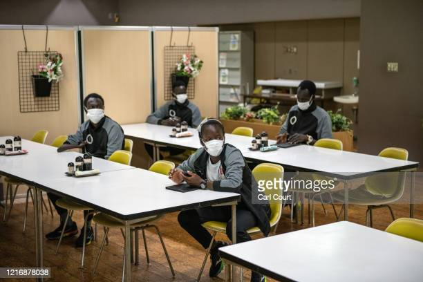 Members of the South Sudanese Olympic team socially distance as they prepare to eat lunch at a canteen in Maebashi City Hall on June 2 2020 in...